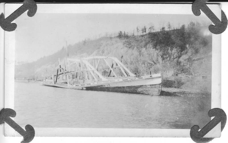 Steamer Mary Powell being broken up in Rondout Creek, upper decks removed, hogging trusses and hull remaining. Wilton Collection, Hudson River Maritime Museum.