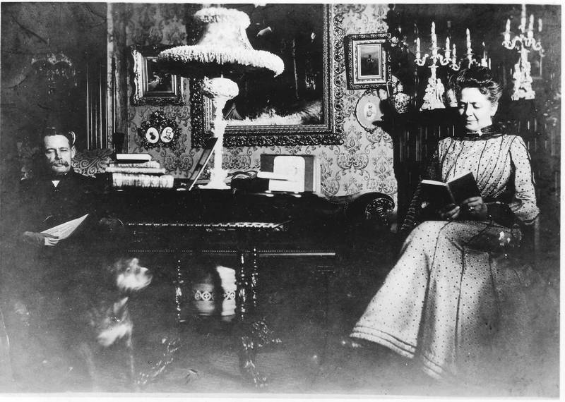 A. Eltinge Anderson, his wife Fanny, and their dog Buster at home in their parlor, undated. Donald C. Ringwald Collection, Hudson River Maritime Museum.