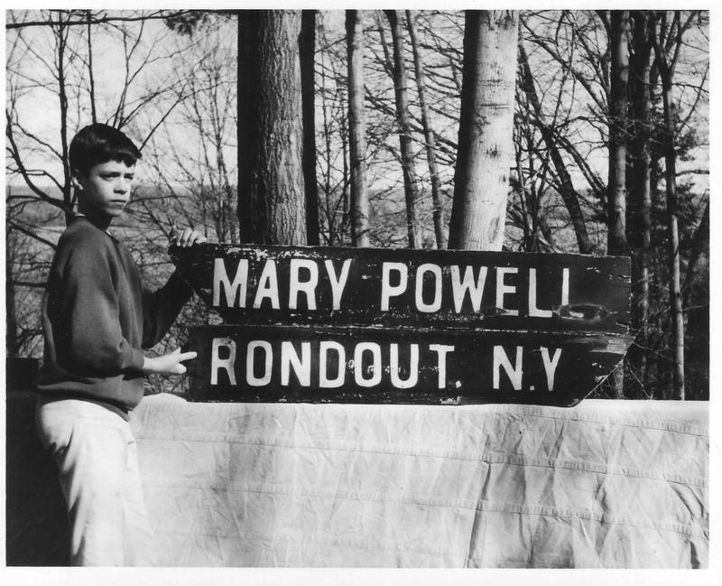 Mary Powell stern boards at Roger Mabie's house in Port Ewen. Billy Mabie in photo, taken March 30, 1968. Donald C. Ringwald Collection, Hudson River Maritime Museum.