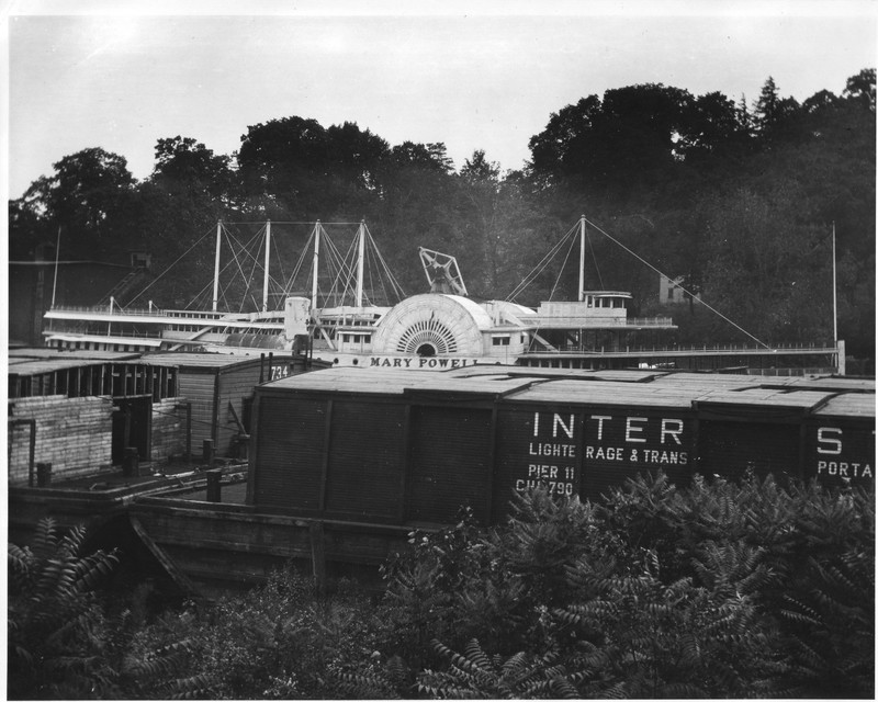 Mary Powell along Rondout Creek beyond covered barges. Note that her smoke stacks have been removed. 1920. Donald C. Ringwald Collection, Hudson River Maritime Museum.