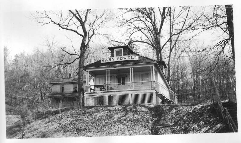 Cottage constructed of timbers from the Mary Powell, with her nameboard over the porch, located in Connelly, NY. Donald C. Ringwald Collection, Hudson River Maritime Museum.